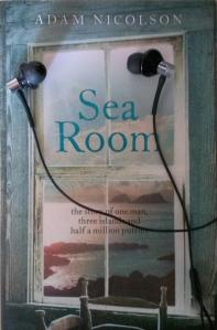 "Adam Nicolson's ""Sea Room"" with headphones resting on it"