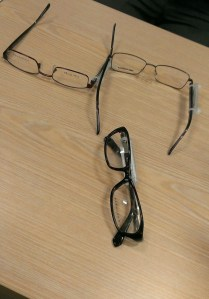 Three pairs of glasses on a desk